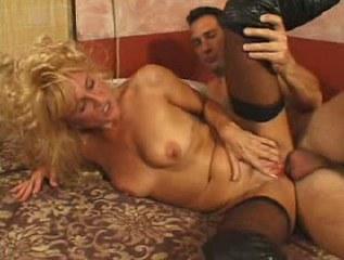 Horny big tit blonde MILF masturbating in bed