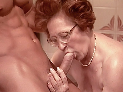 Naughty granny Sabrina seduces a young stud into fucking her on the kitchen floor